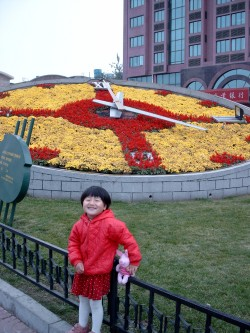 Yanmei in front of a flower clock, just across from our hotel