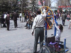 Adult playground. The man next to Yanmei has a wheelchair!