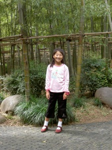 Yanmei infront of the bamboo forest