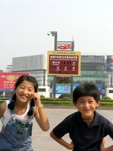 Yanmei and Daji infront of the countdown clock for the Olympics