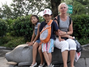 Sitting on a pig in the town park in Guilin